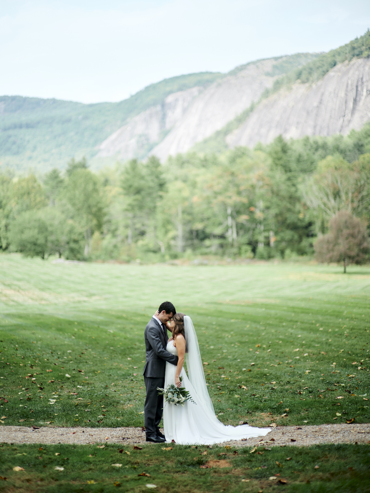Bride and groom portrait with natural scenery